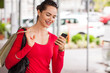 Smiling woman looking at mobile phone