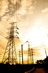 Energy Distribution Network - Electricity Pylons against Orange
