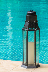 lantern on pool side.