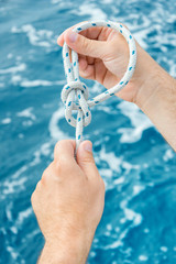 Making of nautical bowline knot