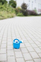watering can on a street