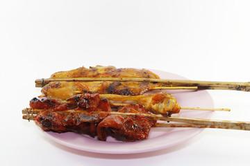 Grilled chicken leg on white background