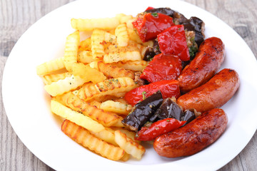 Portion of sausage with tomato