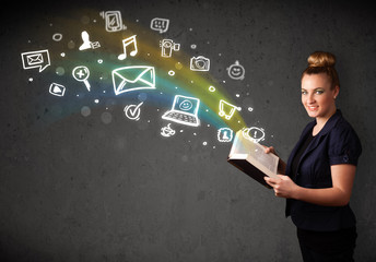 Young woman reading a book with multimedia icons coming out of t