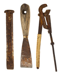 Old isolated tools:chisel, putty knife, adjustable wrench