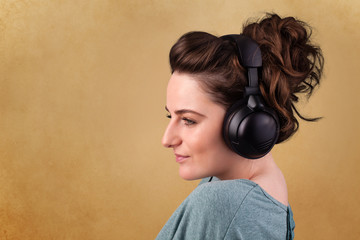 Young woman with headphones listening to music with copy space