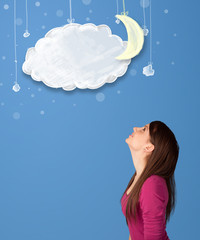 Young girl looking at cartoon night clouds with moon