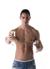Romantic man offering a flute of champagne