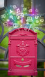 canvas print picture - Colorful icons and symbols bursting out of a mailbox