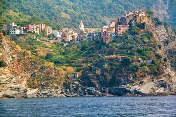 Scenic view of colorful village Vernazza and ocean coast in Cinq