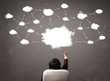 Businessman sitting with cloud technology above his head