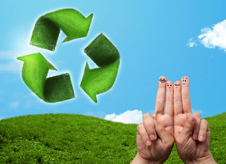 Happy smiley fingers looking at green leaf recycle sign