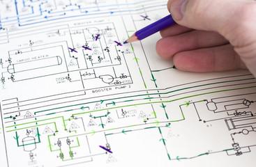 Human hand drawing on blueprint.