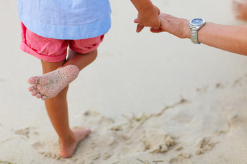 Close up of little girl standing at beach