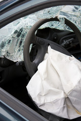 Deployed airbag in crashed car.