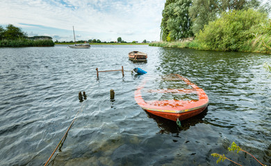 Sunken orange colored row boat