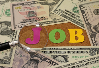 Concept of job search - magnifying glass and money