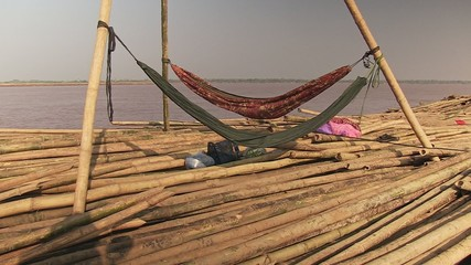 Two hamac set up on the bamboo rafts on the mekong river