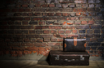 retro bags on brick wall background