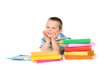 boy with piles of colored books