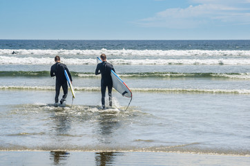 Men in Wetsuit Going to Surf