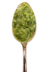 Grüne Suppe auf einem Löffel