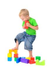 boy destroys toy building