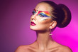 Horizotnal portrait of attractive woman with multicolor make up