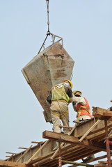 Two construction workers casting beam