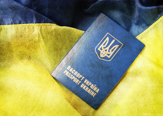blue yellow flag and passport of Ukraine grunge style