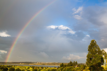 Rainbow over the Guadiana River in Spain, Ayamonte, Huelva,