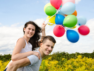 Happiness: Young couple in love with colorful balloons :)