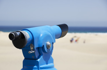 Coin operated binoculars on the beach.