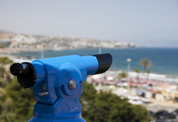 Coin operated binoculars overlooking the beach.
