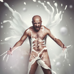 strong sexual man in milk screaming
