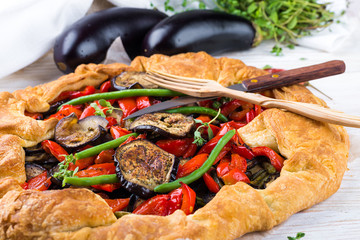 Eggplant pie with peppers and beans