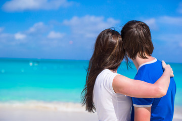 Happy young couple enjoying summer holiday on tropical beach