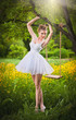 Attractive girl in white short dress posing near a tree swing
