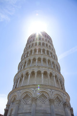 Leaning tower of pisa with sun rays halo