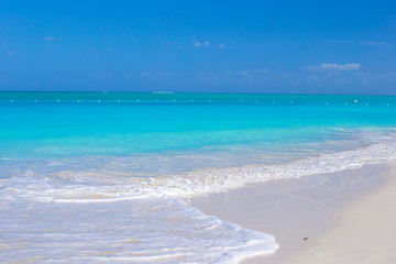 Perfect white beach with turquoise water at ideal island