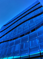 Glass building in overall blue tone