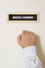 Male patient knocking on Medical Examiner door