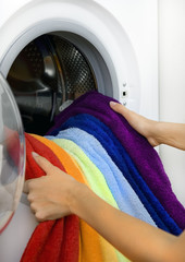 woman taking color laundry from washing machine
