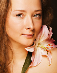 beauty young woman with flower
