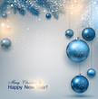 Blue Christmas background with fir twigs and balls. Xmas baubles