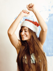 young pretty brunette woman in christmas red hat isolated