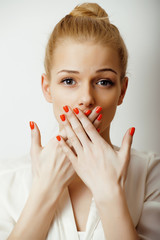 young blond woman emotional in studio