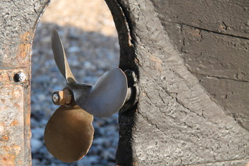The Propeller of a Small Wooden Fishing Boat.