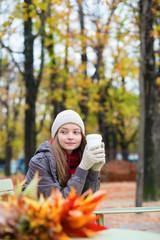 Girl drinking coffee outdoors