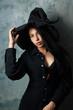 Leinwandbild Motiv girl in a witch costume sexy looks